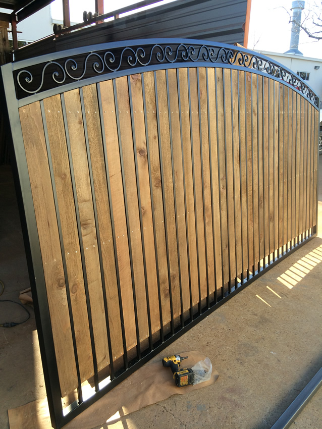 C Arched Driveway Gate With Wood And Scrolls Cactus